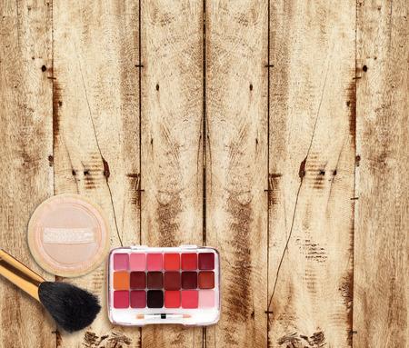 powder puff: Makeup Eyeliner brush with bottle ,set of cosmetics,Make-up and brushes,powder, puff, mascara, eyeliner on wood table Stock Photo