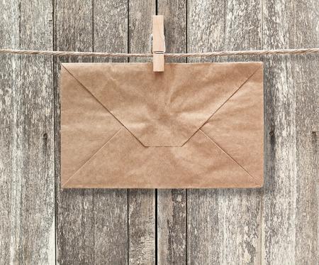 ephemera: Blank card and envelope on old wooden background