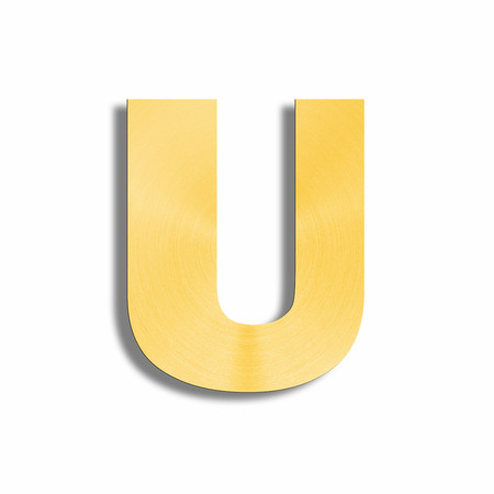 oblique line: 3d rendering of the letter U in gold metal on a white isolated background. Stock Photo