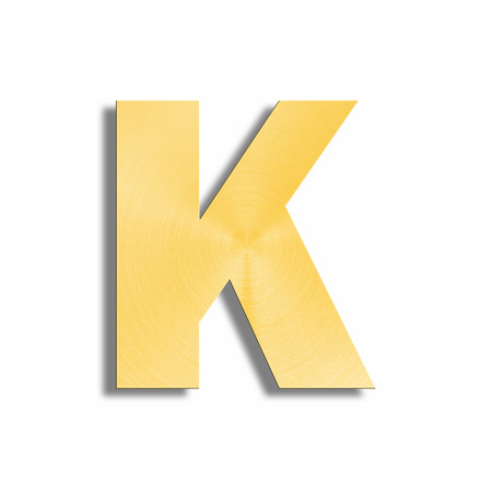 oblique line: 3d rendering of the letter K in gold metal on a white isolated background.
