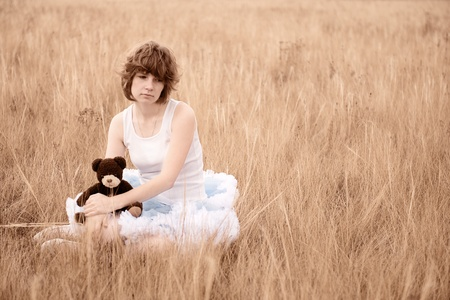 The sad girl in the field photo