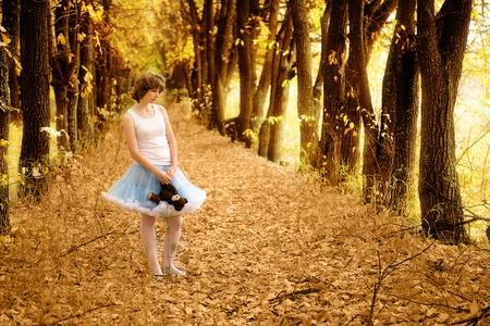 The beautiful girl in fantastic wood photo