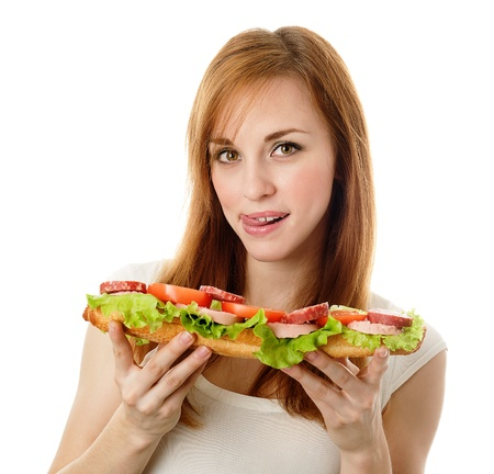 young woman eating fast food. isolated on white  photo