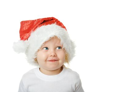 Christmas kid in Santa hat isolated on white background photo