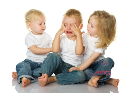 upset man: Two little girls calm the crying boy. isolated on the white background