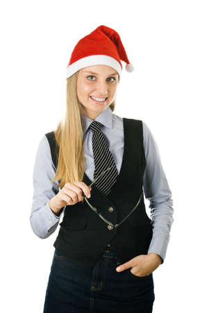 Businesswoman wearing a santa hat with glasses in a hand. isolated on white background photo