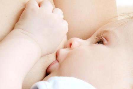 baby feeding: Little baby boy breast feeding