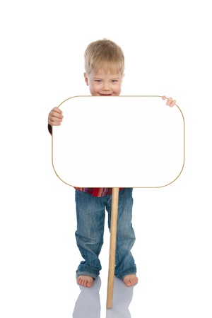 child holding sign: The laughing little boy the holding board with space for text Isolated on a White Background Stock Photo