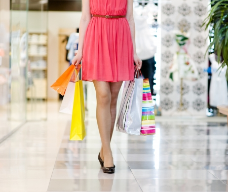 shopping center: Close-up of beautiful female legs during shopping Stock Photo