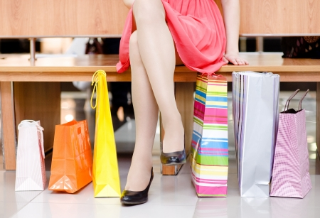 shopping bag: Woman s legs and shopping bags