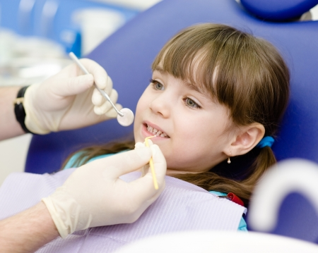 chairs: dental examining being given to little girl by dentist