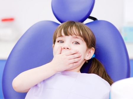 fear child: frightened girl at dentist s office