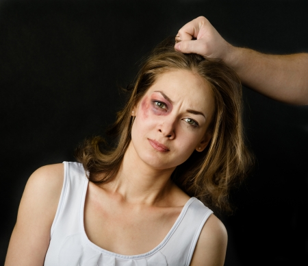 terrified: Domestic violence woman being abused and strangled by strong man  on dark background