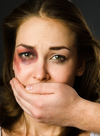abused women: man closes his mouth crying girl