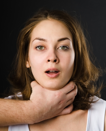 suffocate: Domestic violence woman being abused and strangled by strong man