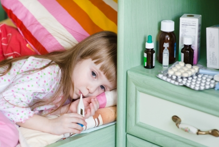sick girl lying on a bed Stock Photo - 20931197