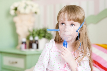 inhalation: little girl makes inhalation home Stock Photo