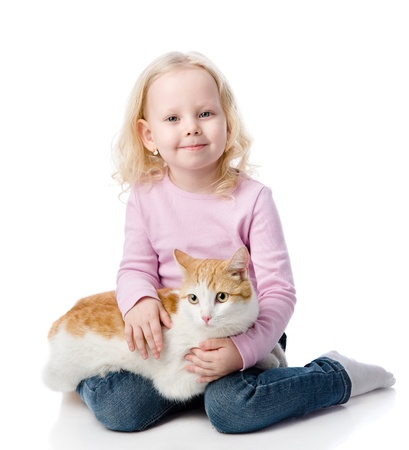 girl playing with cat  looking at camera  isolated on white background