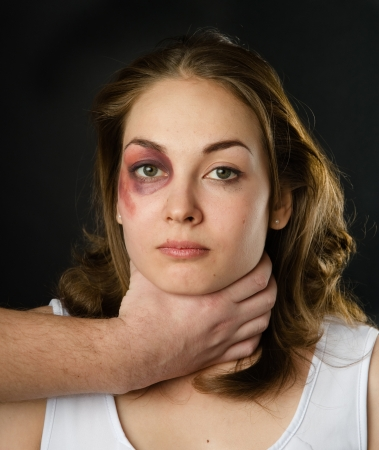 victims: Domestic violence woman being abused and strangled by strong man  on dark background