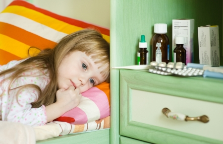 grippe: sick girl lying on a bed Stock Photo
