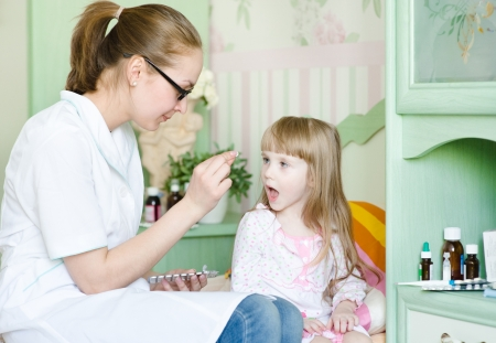 Child receiving pill photo