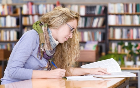 science class: student reads the book in library Stock Photo