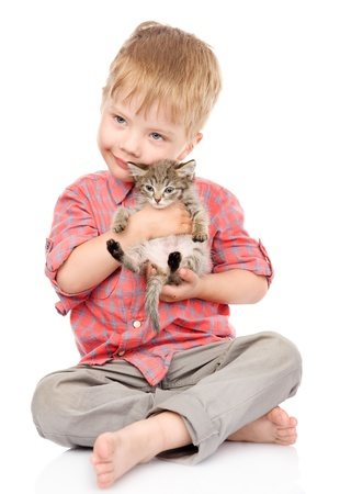whelp: little boy hugging a kitten  isolated on white background