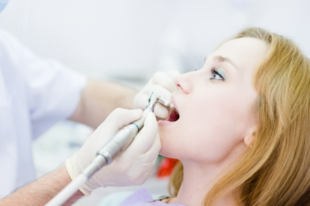 close-up medical dentist procedure of teeth polishing with clean photo
