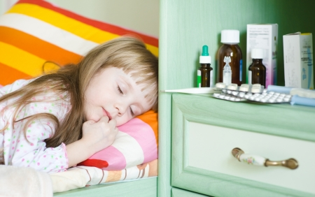 sick girl lying on a bed Stock Photo - 21134486