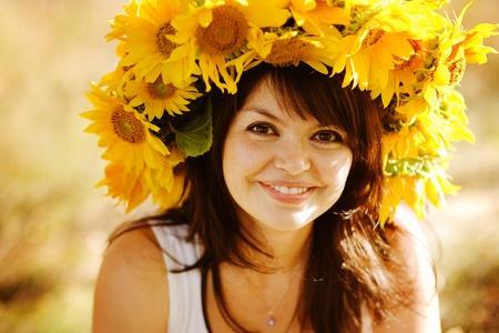 beauty woman portrait with wreath from sunflowers photo
