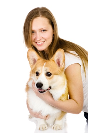 closeup puppy: dog and girl  looking at camera  isolated on white background Stock Photo