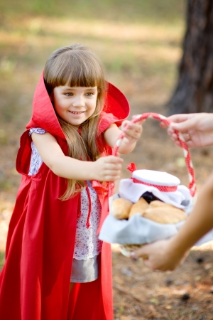 myth: mother hands over to the daughter a basket with food  the fairy tale   Red Riding Hood