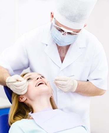 dental mirror: girl visit to the dentist