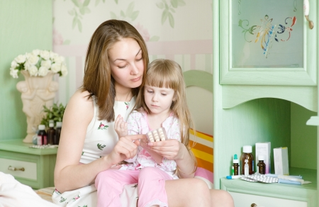 caucasian fever: mother and sick girl Stock Photo