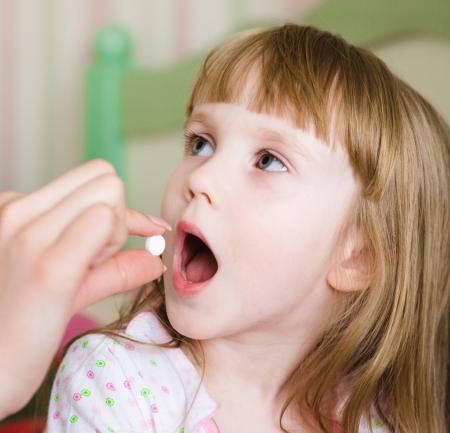 pilule recevoir des enfants - gros plan photo