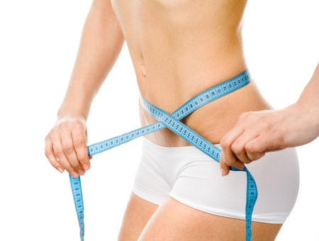 woman with beautiful body  with measurement type after diet, isolated on white background photo