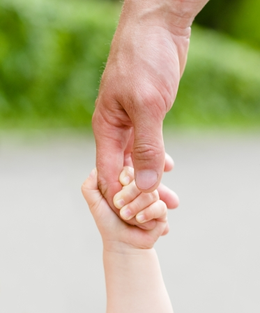 human kind: Child holding father s hand Stock Photo