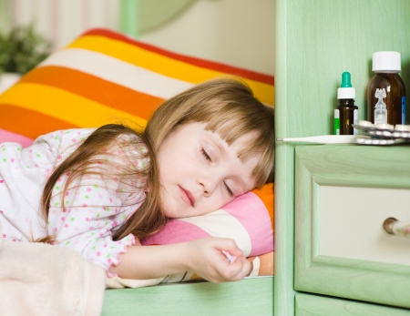 sick girl lying on a bed Stock Photo - 22023000