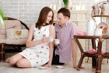beautiful young couple drink coffee hold cup photo