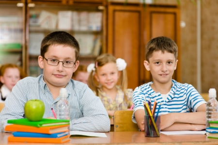 Portrait of  pupils looking at camera in classroom photo