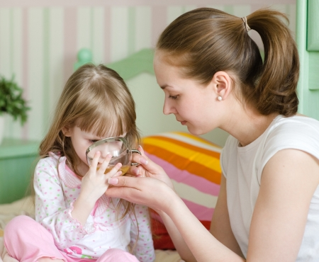 mother gives to drink to the sick child Stock Photo
