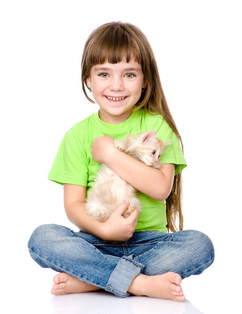 little  girl hugging kitten  isolated on white background photo