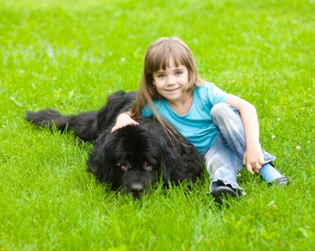 Newfoundland: Girl with Newfoundland dog Stock Photo
