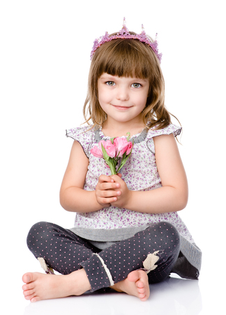 beautiful girl with a crown on his head and a bouquet in her hands photo