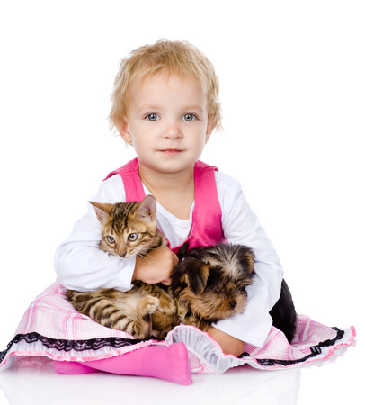 little girl hugging a kitten and a puppy  isolated on white background photo