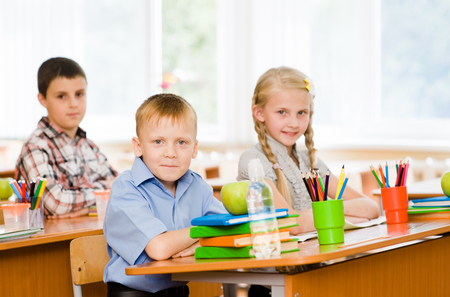 Portrait of schoolkids looking at camera at workplace Stock Photo - 22883009