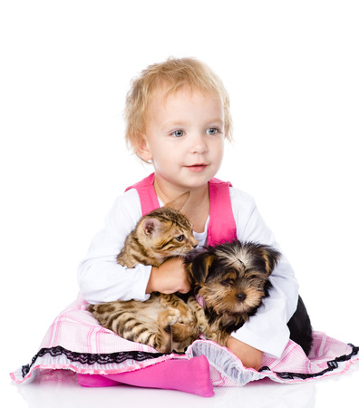 little girl hugging a kitten and a puppy  isolated on white background Stock Photo - 22883016