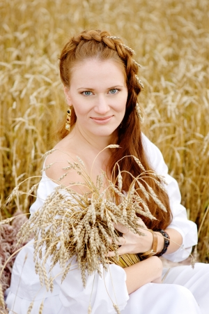 Beautiful  lady in wheat field  looking at camera photo