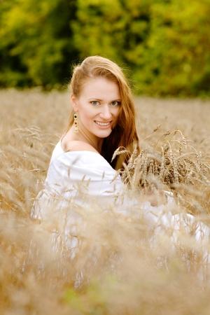 girl enjoying life in wheat meadow photo