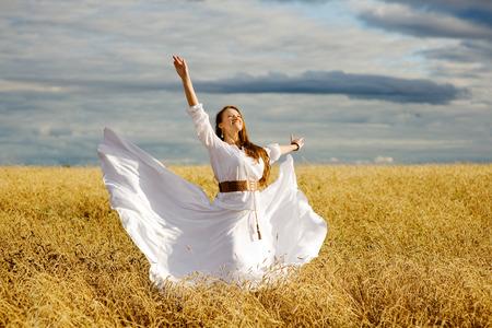 Beautiful Happy Girl Having Fun on the Wheat Field photo